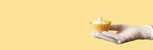 Yellow Monochrome Bakery. Sustainable Cupcake Cup. Hold In Hand. Gold Maffin Cream. Trendy Colourful Desert. Bright Birthday Gift. Horizontal Banner With Copyspace. Protective Glove