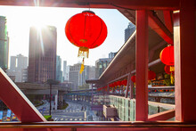 Overhead Pedestrian Walking Bridge With Traditional Chinese Red Lamps Leads To Nearby Facilities.