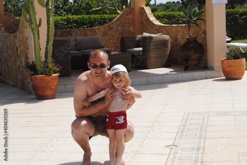 Carta da parati Portrait Of Father And Son At Poolside In Resort