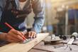 Leinwandbild Motiv Midsection Of Carpenter Working At Workshop