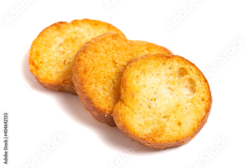Foto Large Baguette Croutons Toasted and on a White Background