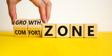 Comfort Or Growth Zone Symbol. Hand Turns Wooden Cubes And Changes Words 'comfort Zone' To 'growth Zone'. Beautiful Yellow Table, White Background, Copy Space. Business, Psychology Concept.