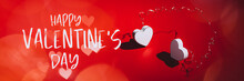 Happy Valentines Day Text On Card. Two White Wooden Hearts With Strong Shadows On Red Background Connected Together, As Symbol Of Love And Passion, Happy Valentines Day Concept, Banner Size