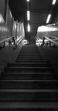 Low Angle View Of Steps In Illuminated In Subway Station