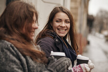 Communication And Friendship Concept - Smiling Young Women With Coffee Cups