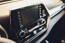 Leather Car Interior. Modern Car Illuminated Dashboard. Luxurious Car Instrument Cluster. Close Up Shot Of Automobile Instrument Panel. Modern Car Interior Dashboard And Steering Wheel.