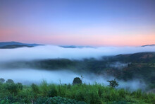 Selective Focus Of View Nature Mountain With Fog In Beautiful Sunrise At Nan Province Of Northern Thailand.