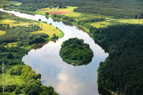 Obraz Scenic View Of Green Landscape And Lake Against Sky - fototapety do salonu