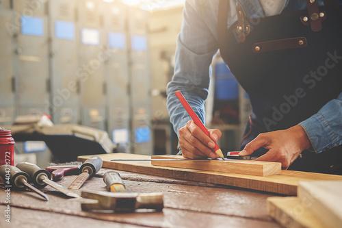 Midsection Of Carpenter Working In Workshop Fotobehang