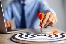 Businessman Holding A Darts Aiming At The Target Center Business Goal Concept - Business Targeting, Aiming, Focus Concept,metaphor To Target Marketing Or Target Arrow To Business Successconcept.