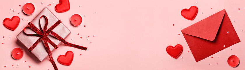 Valentines day banner. Red envelopewith, Gift box and hearts on pink background. Romantic concept