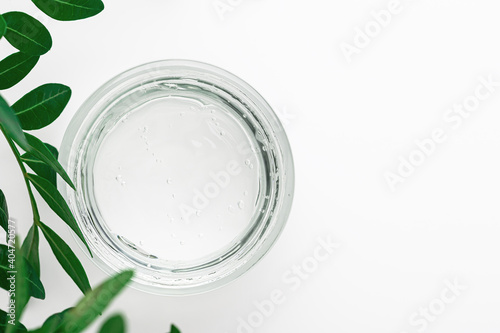 Transparent gel with bubbles texture in a transparent jar top view. Organic bio cosmetics, eco-friendly product for face and body skin care. Beauty cosmetics, cream with plant extracts.