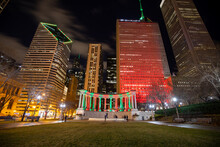 Chicago, Illinois, USA - December 23 2020: Chicago Downtown At Night. Jay Pritzker Pavilion With Christmas Light, View From Millennium Park.