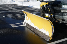 Truck With Snowplow Installed In The Parking Lots
