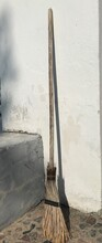 Close-up Of Broom Against Wall