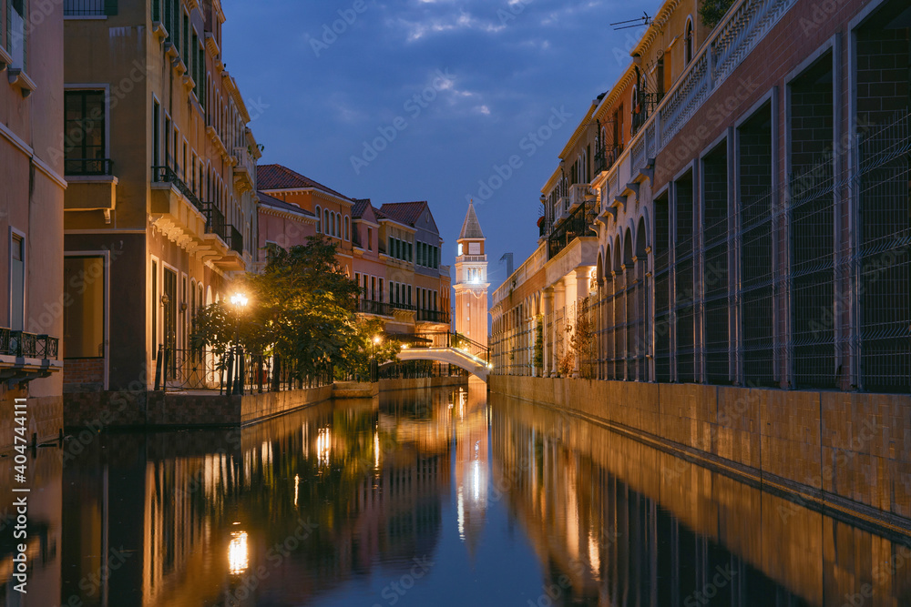Fototapeta Venice Vacharaphol with canal in Bangkok City, Thailand in Italian concept. Italy town. Europe architecture. Tourist attraction at night.