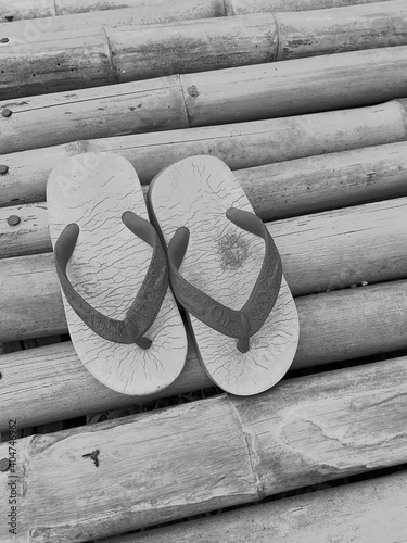 Tela High Angle View Of Flip-flops On Bamboos