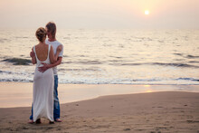 Justmarried Couple Running On A Sandy Beach