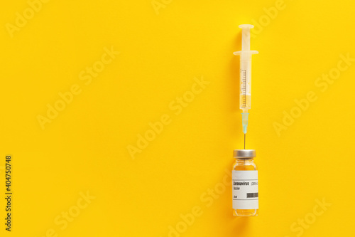 Vaccine for immunization against COVID-19 and syringe on color background Fototapeta