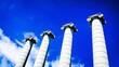 Leinwandbild Motiv Low Angle View Of Architectural Columns Against Blue Sky