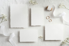 Vintage Wedding Invitations Template. Top View Blank Paper Cards, Ribbon, Golden Rings. Wedding Stationery Set.