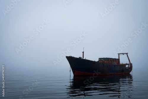 Canvas Print Shipwreck In Sea Against Clear Sky