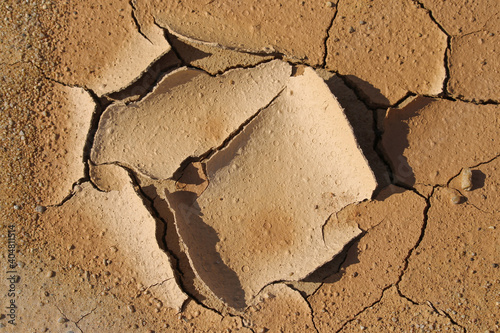 Fotografiet Raindrops marked on dry mud in late summer in an arid mining operation in Spain
