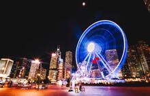 Ferris Wheel In Big City At Night