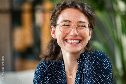 Natural young woman laughing