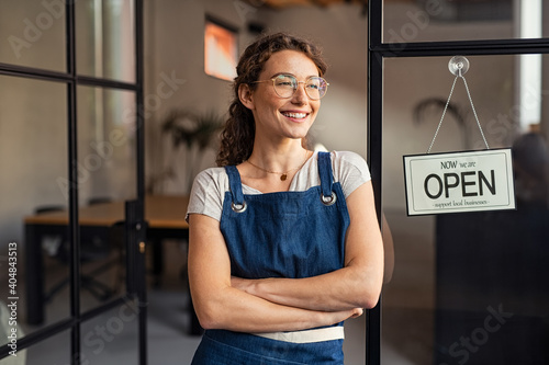 Fototapeta Small business owner standing at cafe entrance