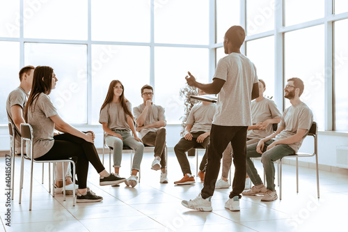 group of young people at a seminar in the conference room Wallpaper Mural