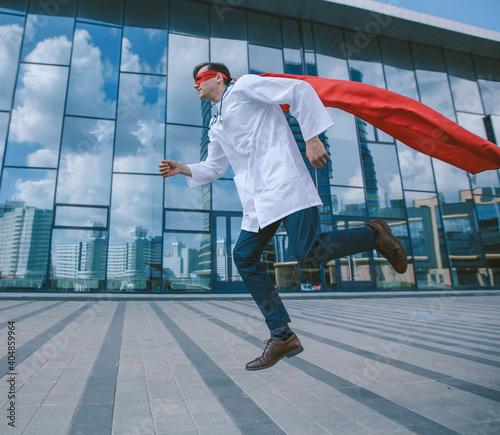 Billede på lærred medic superhero hurries to the sick city resident.