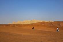 Desert Dunes At Al Awir Desert Near Dubai With Buggy Vehicle At Sunset Light. Dubai, United Arab Emirates, Middle East.