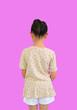 Leinwandbild Motiv Rear view of asian little child girl with bun hair up isolated on pink background