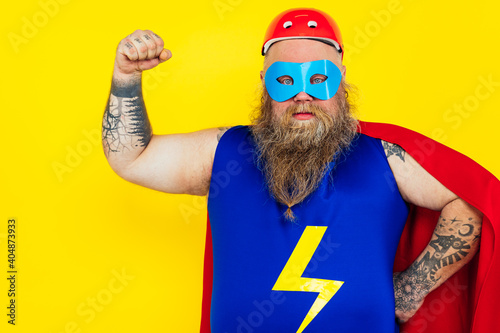 Foto Funny man wearing a superhero costume
