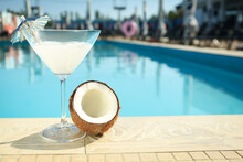 Tasty Refreshing Cocktail And Coconut On Edge Of Swimming Pool. Party Items