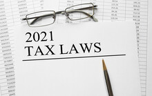 Paper With 2021 Tax Laws On A Table
