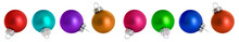 Close-up Of Multi Colored Baubles Against White Background