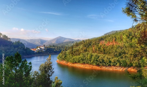 Fotografie, Obraz Scenic View Of River By Mountains Against Sky