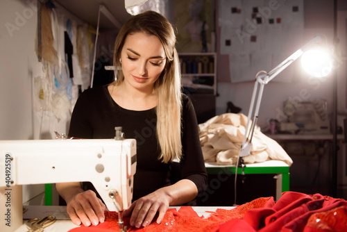 Fototapeta Process of sewing in atelier or workshop