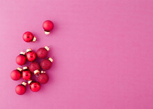 High Angle View Of Christmas Baubles Against Pink Background
