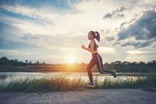 Full Length Of Girl Running On Footpath Against Sky