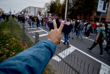 October 11 2020 Minsk Belarus A Man Shows A Freedom Sign With His Hand During A Nearby Demonstration