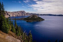 This Is Crater Lake National Park In Oregon, Captured At A Viewpoint On The Rim Drive. This Lake Is A Stunning Blue-violet Color.
