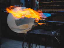 Creating Traditional Glass Art With Hot Torch And Glassblowing Pipe.