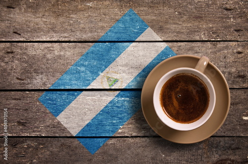 Fotografia Directly Above Shot Of Coffee Served By National Flag Painted On Wooden Table