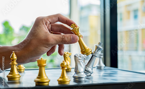 Cropped Hand Of Businessman Playing Chess On Desk In Office Fotobehang
