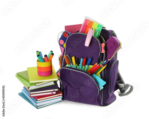 Obraz Purple backpack with different school stationery on white background - fototapety do salonu