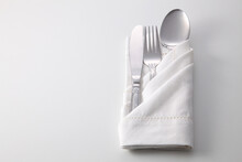 High Angle View Of Eating Utensils And Napkin On White Background