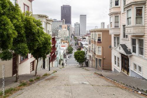 Fotografiet Street Amidst Buildings In City Against Sky